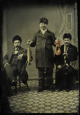 Three Men with Fish & Lobster Unidentified Photographer.  Tintype,  Carte de Visite format (approx. 2.25 x 4 inches)  Daguerre's American Legacy, p. 215; included in MIT Museum exhibition: Also available as a postcard from the MIT Museum bookstore.