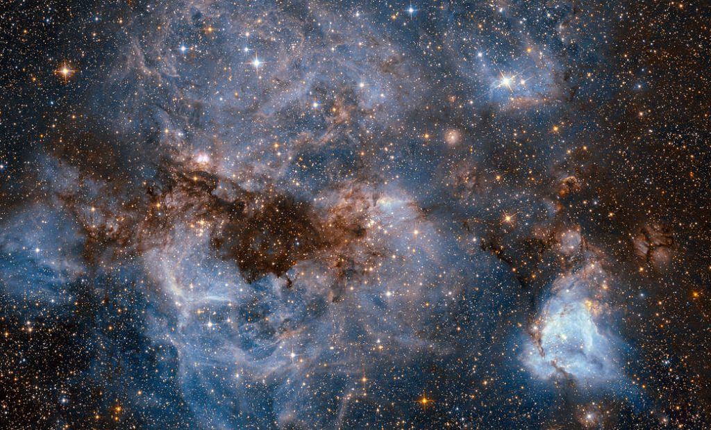 This shot from the NASA/ESA Hubble Space Telescope shows a maelstrom of glowing gas and dark dust within one of the Milky Way's satellite galaxies.