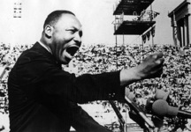 © Martin Luther King Jr. delivers a speech at Soldier Field in Chicago. Credit Afro Newspapers/Gado